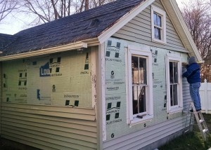 Side 1 nearly complete. Side 2 siding and flashing removed