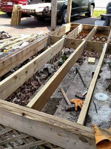 open deck revealing new joists and old joists