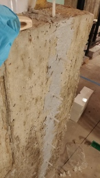 Inserting an epoxy resin to fill in a vertical crack